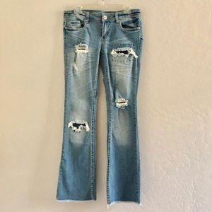 Distressed light wash jean